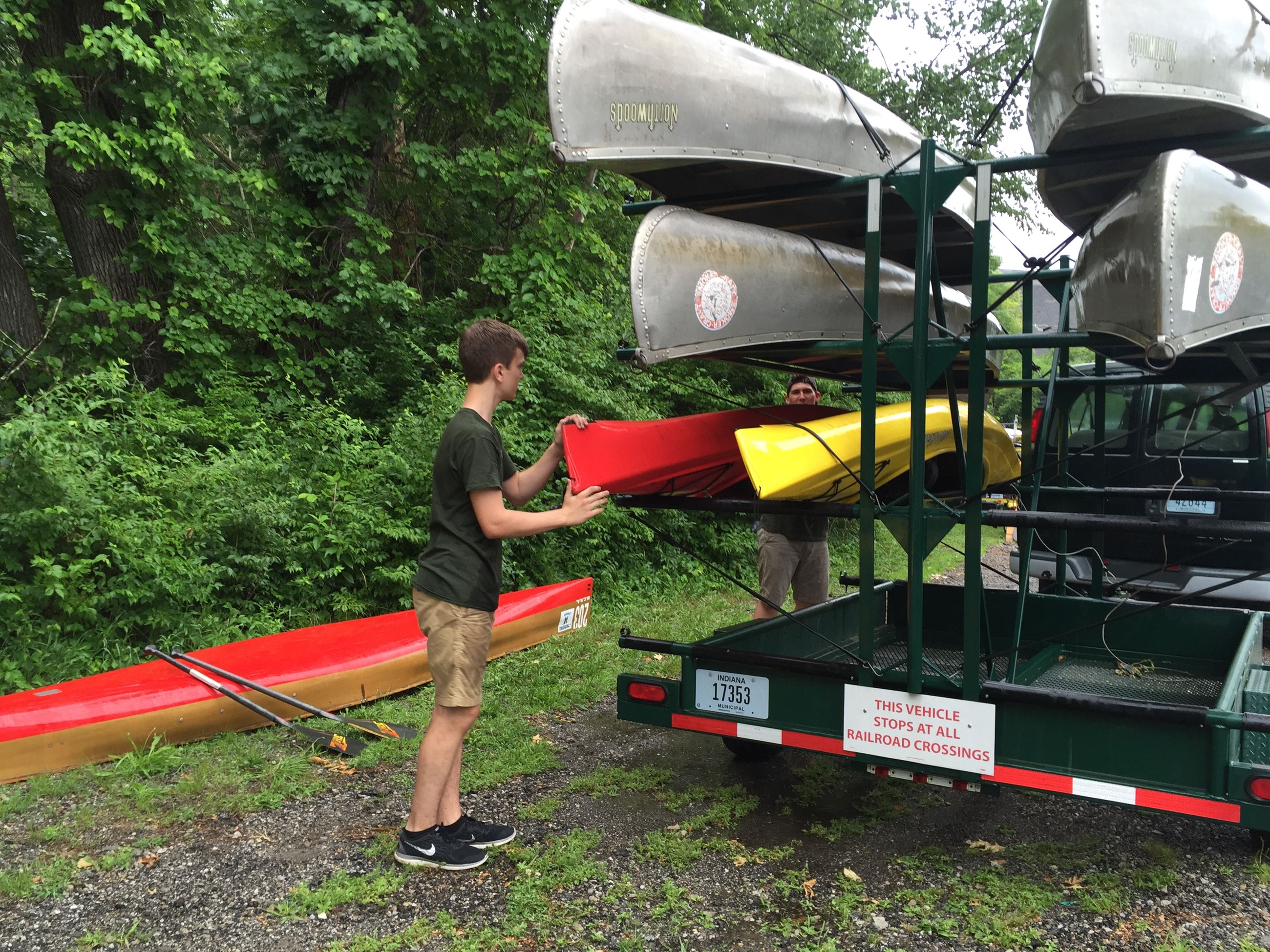 canoe rental staff at St. Patrick&#39s County Park loads trailer