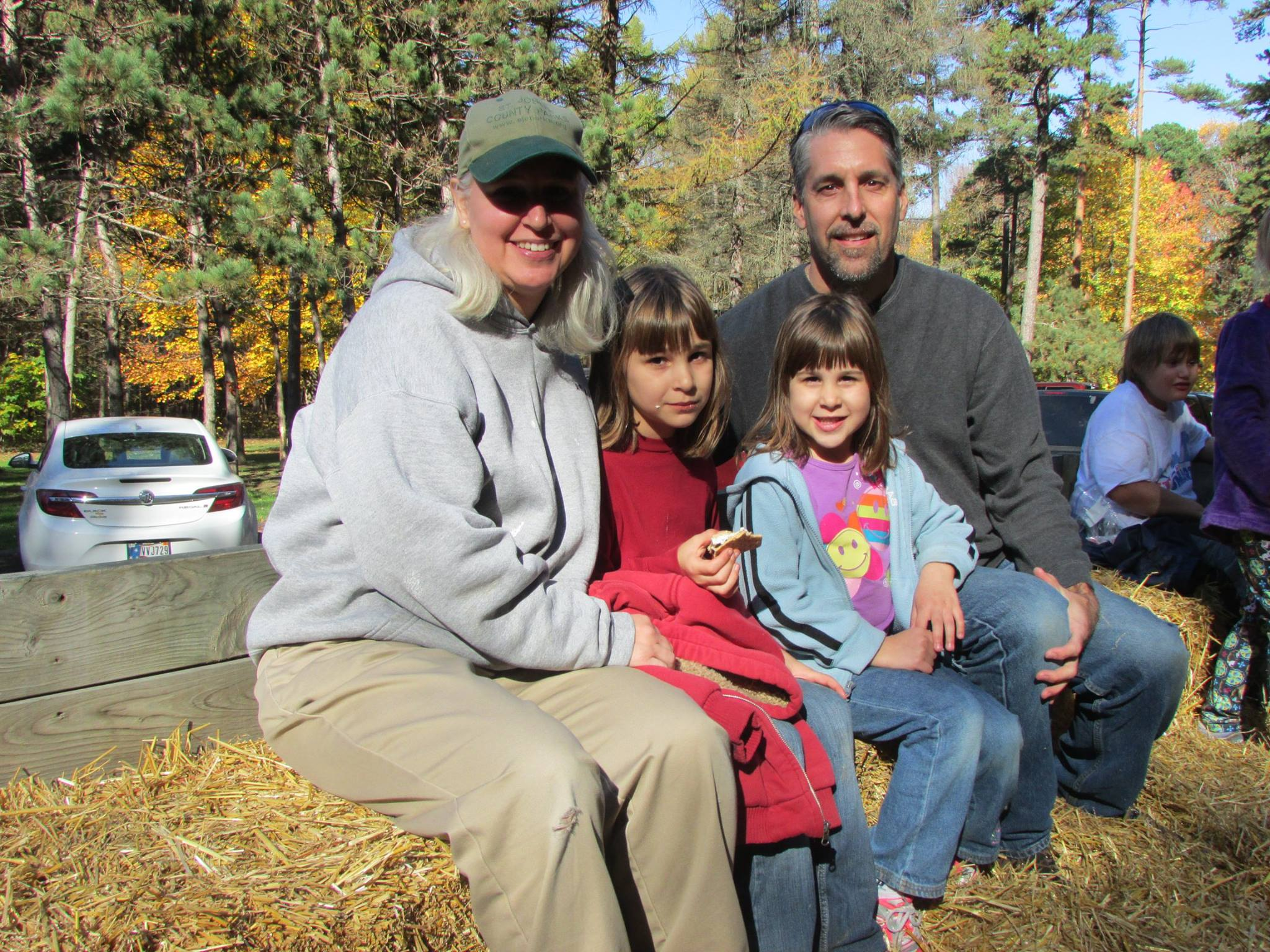 a family enjoys a hayride at Bendix Woods County Park