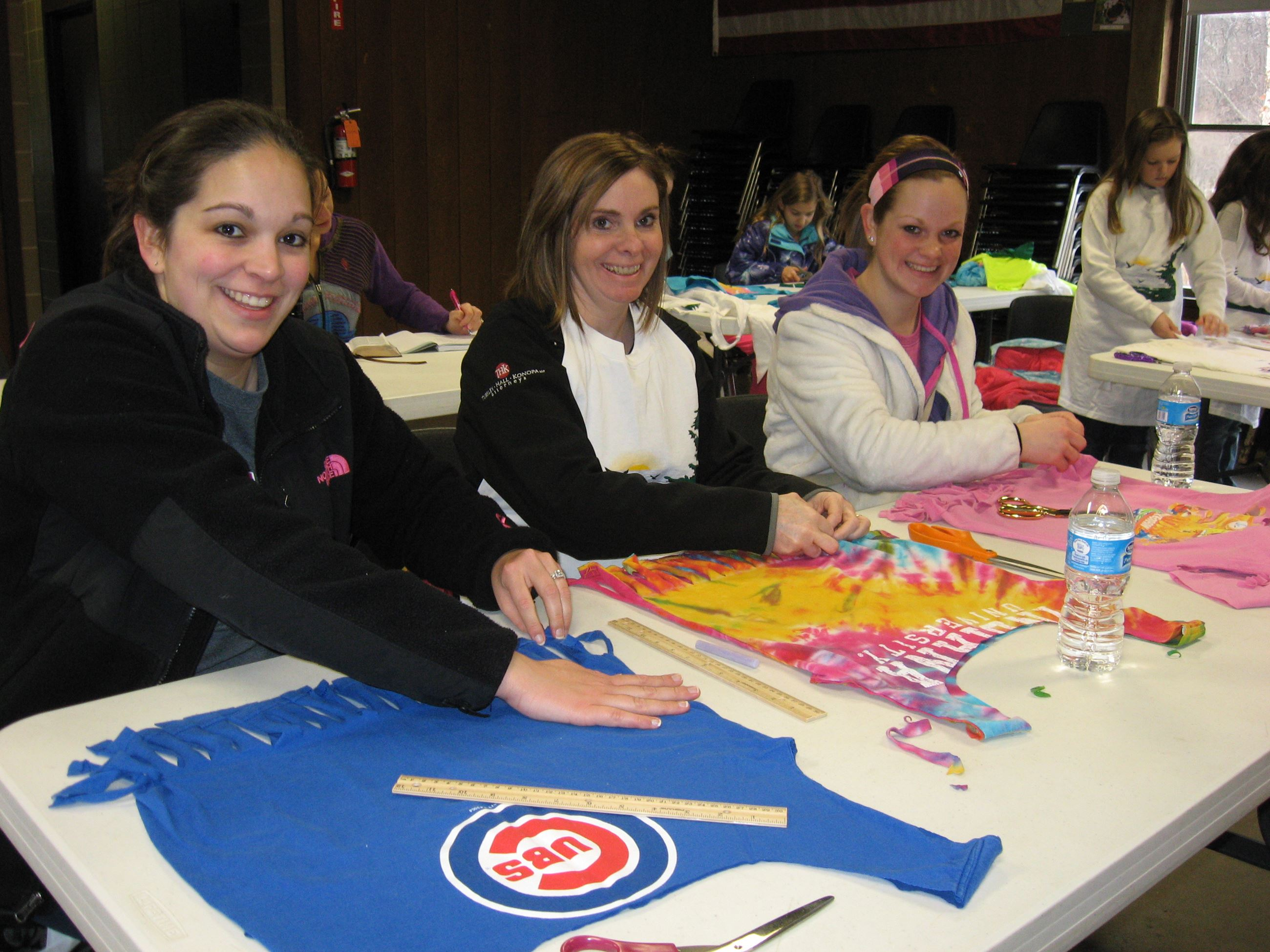 workshop participants create totes and aprons from old T shirts