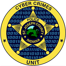 This is an image of the gold badge for the Cyber Crimes Division