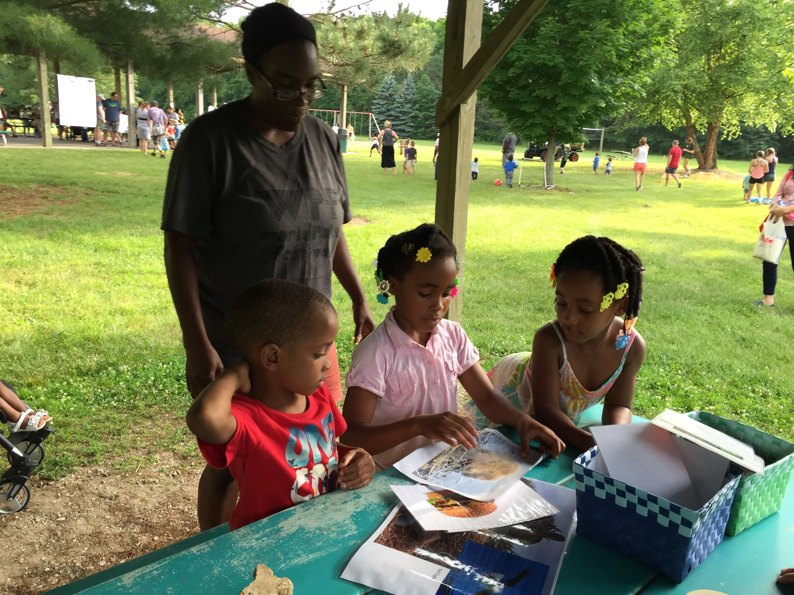 A family enjoys a nature activity with park naturalist