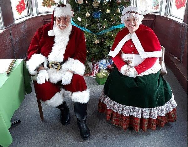 Mr. and Mrs. Kringle sit in a chair